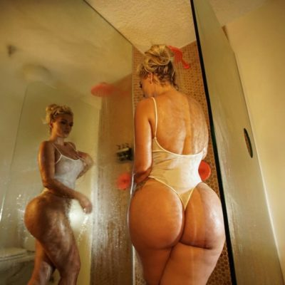 Busty Blonde in the shower