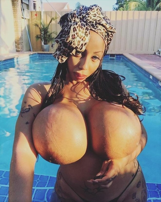Ebony with Giant Fake Boobs