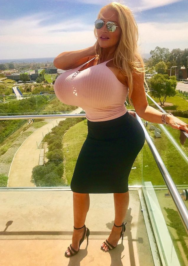 Allegra Cole in tight top and skirt
